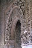 Fragment of the wall in the Moorish castle. Openwork carving on a stone. Medieval Moorish castle in Spanish Granada. Fragment of the arch and the wall in the Stock Photo