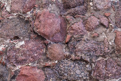 Fragment of the wall natural close-up red granite stone Royalty Free Stock Image