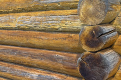 Fragment of the wall of an old log house Royalty Free Stock Photo