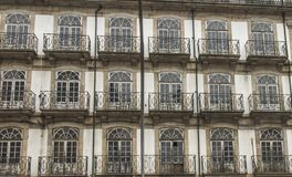 Fragment of the wall of an old tenement house with windows in th stock photo