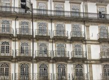 Fragment of the wall of an old tenement house with windows in th royalty free stock photo