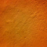 Fragment of the wall, painted in orange color Stock Images