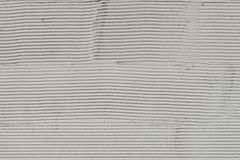 Fragment of a wall with scratches and cracks. White cement background with patterns royalty free stock image