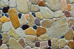 Fragment of the wall of the various types of stone. Background of different natural stones Royalty Free Stock Images