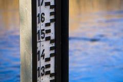 Fragment of water level measurement gauge. Water level measurement gauge used to monitor the water levels stock images
