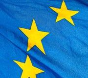 A  fragment of the waving European Union Flag. Fragment of the waving European Union Flag in sunshine Stock Photo
