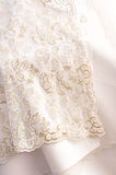 Fragment of a wedding dress Stock Images