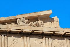 Fragment of the western pediment of the Parthenon in the Athens. ATHENS, GREECE - SEPTEMBER 21, 2012: These are sculptural details of the western pediment of the Stock Image
