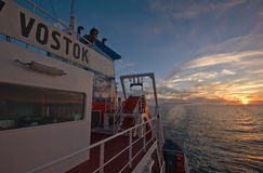 Fragment wheelhouse of the ship on a background of sea sunset. Royalty Free Stock Images