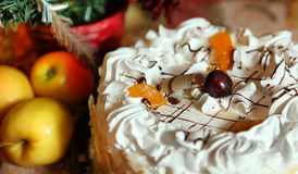 Fragment of white cake with cherry and apricot apples Stock Image