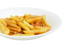 Fragment of white dish with French fries Royalty Free Stock Photos