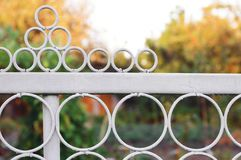 Fragment of a white metal fence with round elements royalty free stock photos
