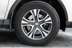 Fragment of white modern car with wheel Stock Images