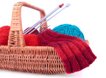The fragment of the wicked basket with knitting Stock Photos