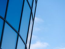 Fragment of a window of a high office building against a sky stock photos