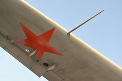 Fragment of a wing of the Soviet military plane amphibian against the blue sk Stock Image