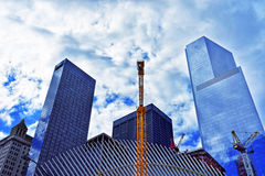Fragment of wing of WTC Transportation Hub and Financial District. New York, USA - April 24, 2015: Fragment of wing of WTC Transportation Hub and Skyscrapers in Stock Photo