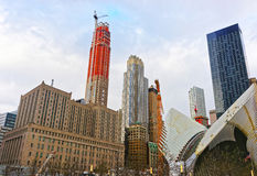 Fragment of wings of WTC Transportation Hub and Financial District. New York, USA - April 24, 2015: Fragment of wings of WTC Transportation Hub and Skyscrapers Royalty Free Stock Image