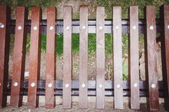 Fragment of a wooden brown bench, close-up. Wood texture stock photo