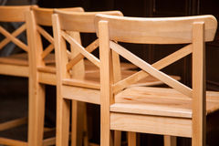Fragment of wooden chairs Royalty Free Stock Image