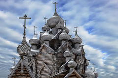 A fragment of a wooden Christian Church with domes in the foreground Stock Photography