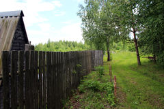 Fragment of wooden construction and a fence in the village Stock Photo