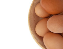 A fragment of a wooden dish with chicken eggs Royalty Free Stock Photo
