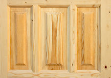 Fragment wooden door made of coniferous tree. On white background Stock Photography
