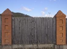 Fragment of a wooden fence stock photos