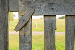 Fragment of a wooden fence with a revolving latch Royalty Free Stock Image