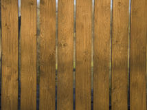 Fragment of wooden fense. At sunny day Royalty Free Stock Images