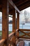 Fragment of a wooden gazebo overlooking the garden. Recreation. stock photo