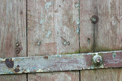 Fragment of a wooden old door. Old gray wooden door fragment background and texture Stock Photography