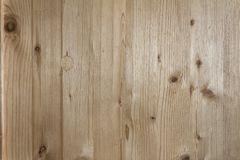 A fragment of a wooden panel hardwood. Texture background Stock Photos