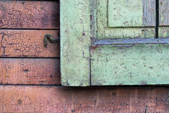 Fragment of wooden shutters on an old house wall Stock Photo