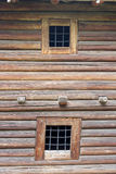 Fragment of wooden wall made of logs. Stock Photos