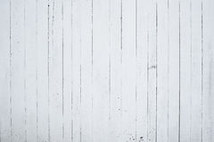 A fragment of wooden wall painted with lime, the back side of the house. Wooden wall painted in white by lime. The back side of the house. Countryside Stock Photo