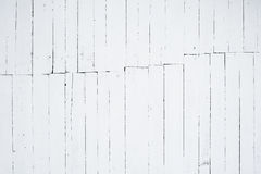 A fragment of wooden wall painted in white by lime and seam in the middle of the image Stock Photography