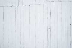 A fragment of wooden wall painted in white by lime and seam in the top of the image Royalty Free Stock Photo