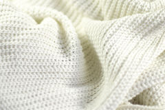 Fragment of a wrinkled knitted white Stock Photo