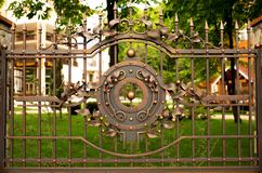 Fragment of wrought iron fence gate Stock Photography