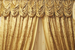 Fragment of a yellow portiere Stock Photo