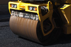 Fragment of yellow roller, urban road is under construction Royalty Free Stock Photos