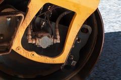 Fragment of yellow roller wheel, urban road Royalty Free Stock Photo
