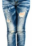 Fragmentary and torn jeans. Leg of women in fragmentary and torn jeans on white background Stock Photography