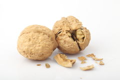 The fragmentation of the walnut. The white background of walnut Stock Photos