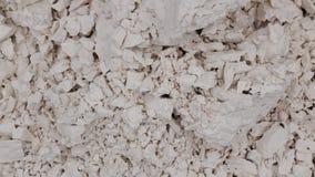 Fragmentation of white rock chalk, plaster, putty... Stock Image