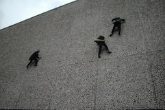 Fragmente. APRIL 12, 2006 - BERLIN: cat burglars at the fassade of the German Opera building during a promotional event for an upcoming opera play, Berlin Stock Photos