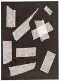 Fragmente eines klebrigen Bandes. Stockbild