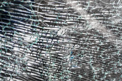 Fragmented Cracked Glass Pattern. Cracked safety glass in closeup with nobody visible Royalty Free Stock Images